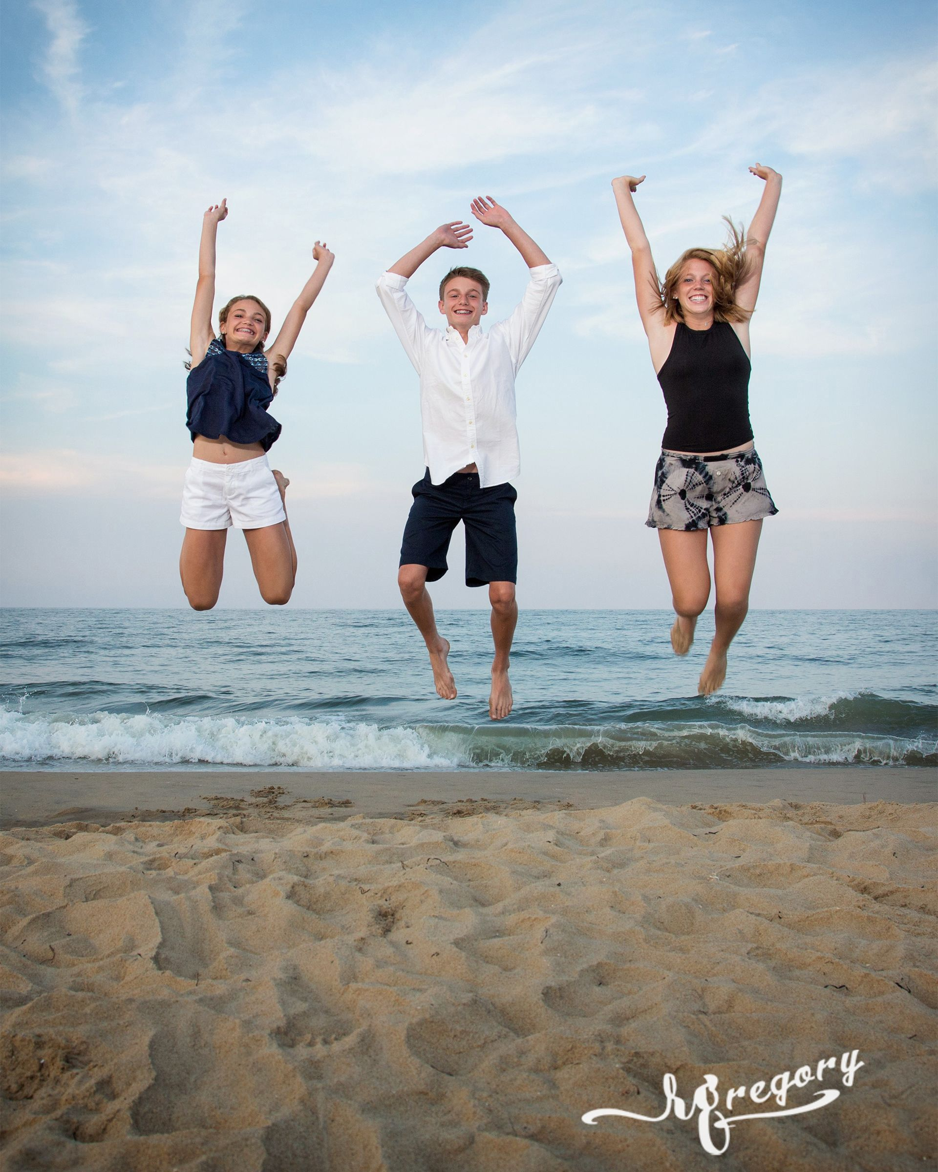 BROWN family jumping in air beach photography