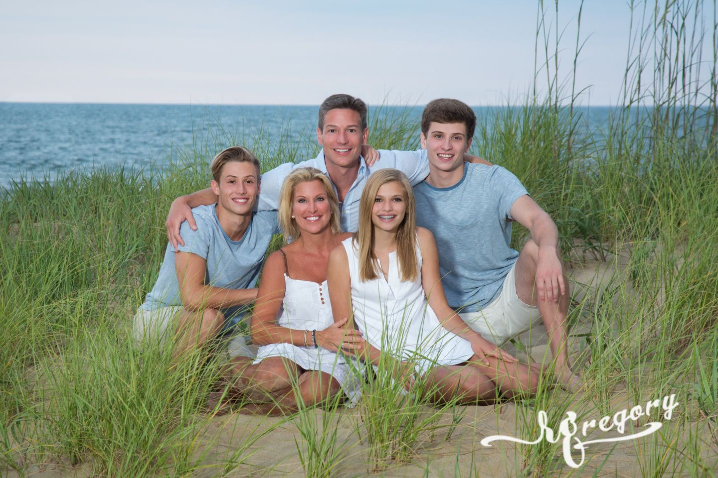 Mayer family portrait on beach in grass va