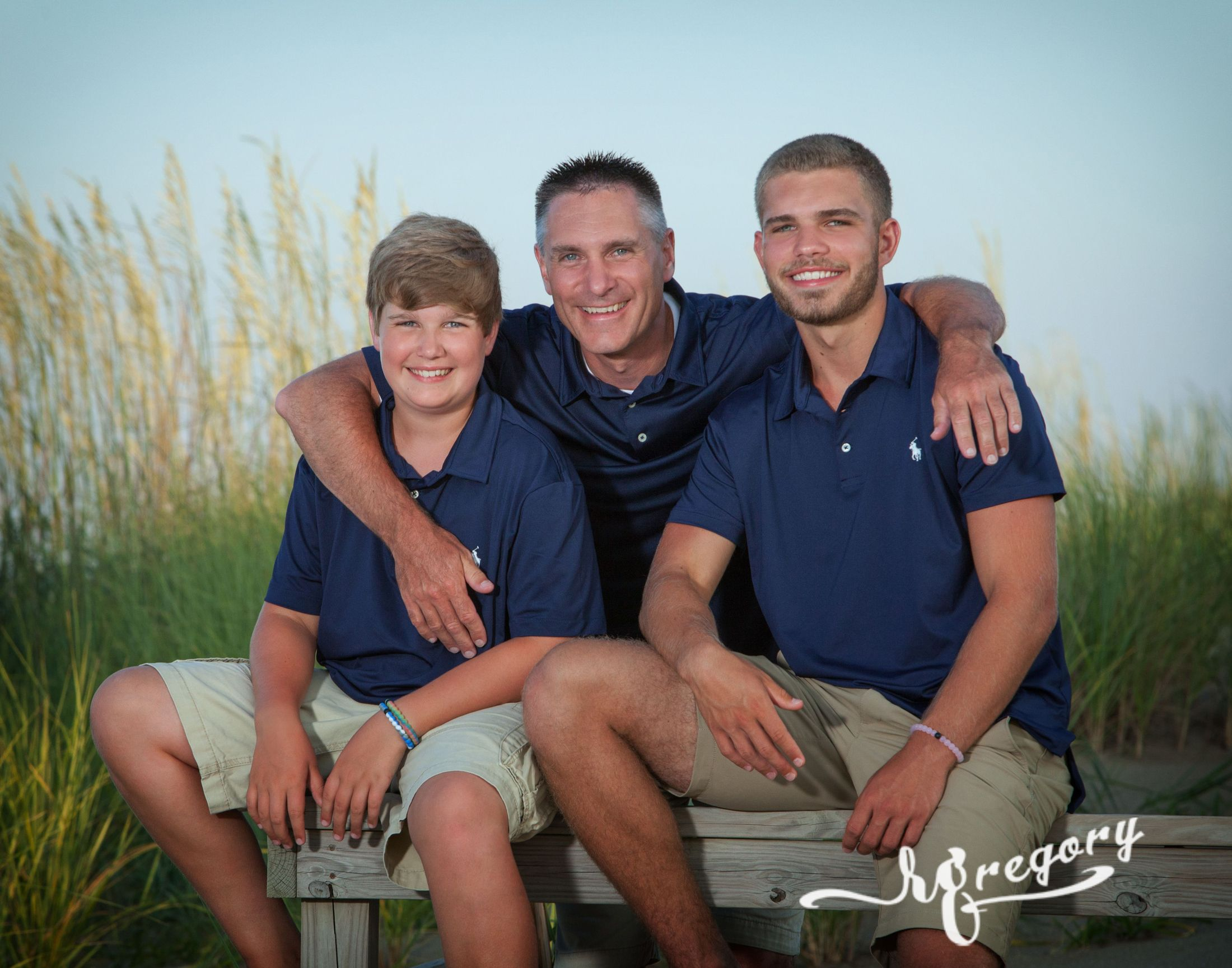 Phillippi father child son beach grass vacation photographer