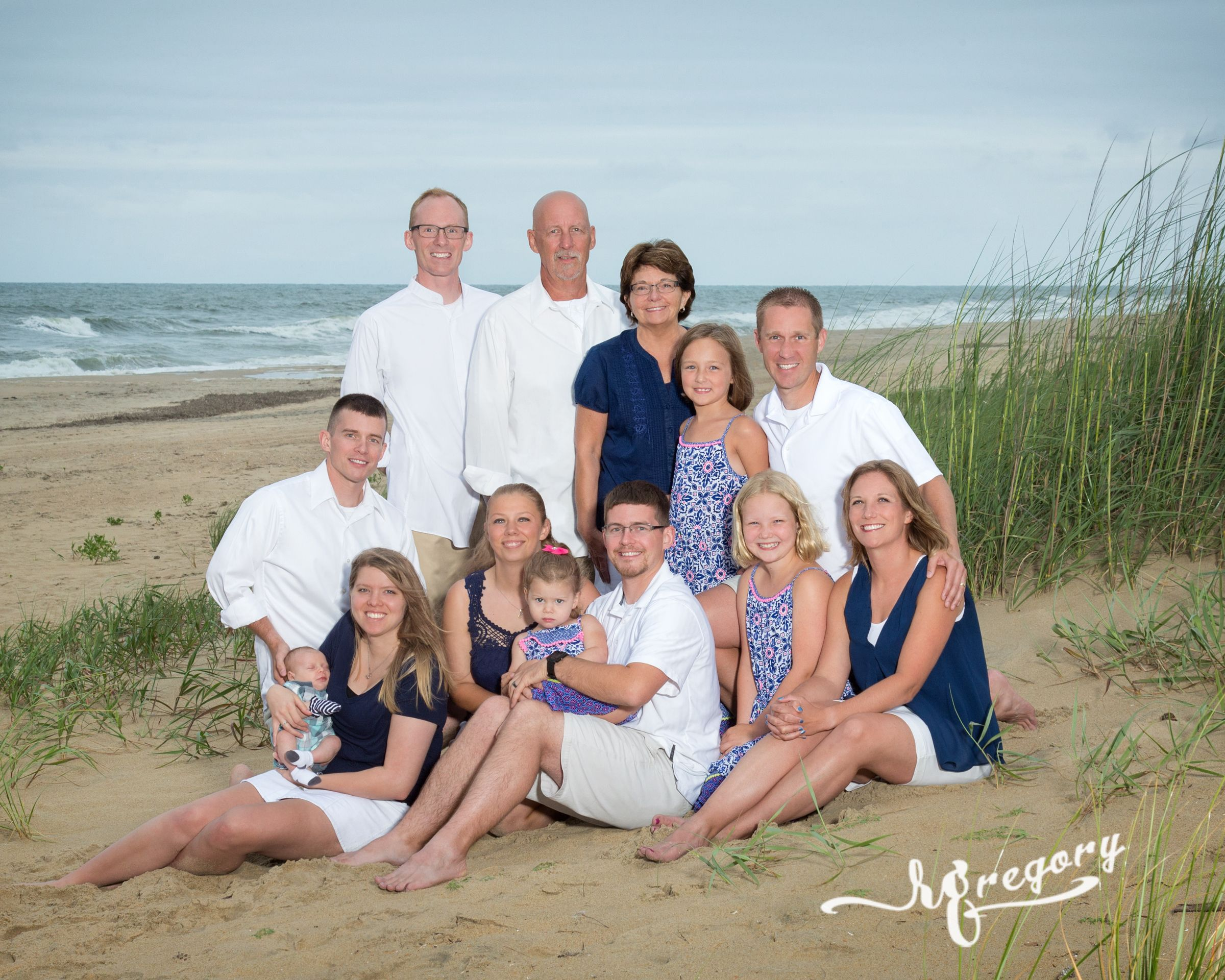 Rader family portrait on beach ocean in back