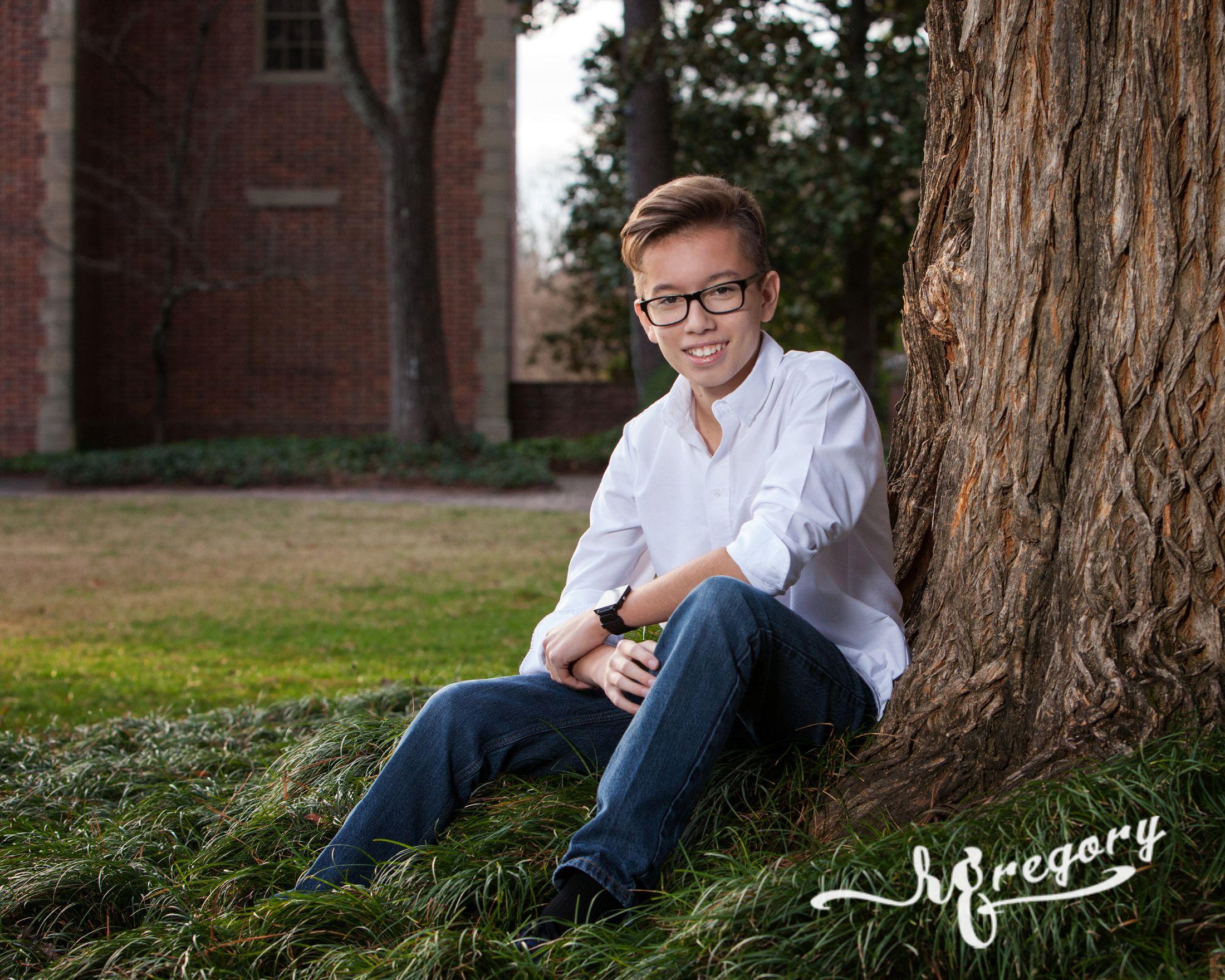 Garcez child sitting against tree portrait