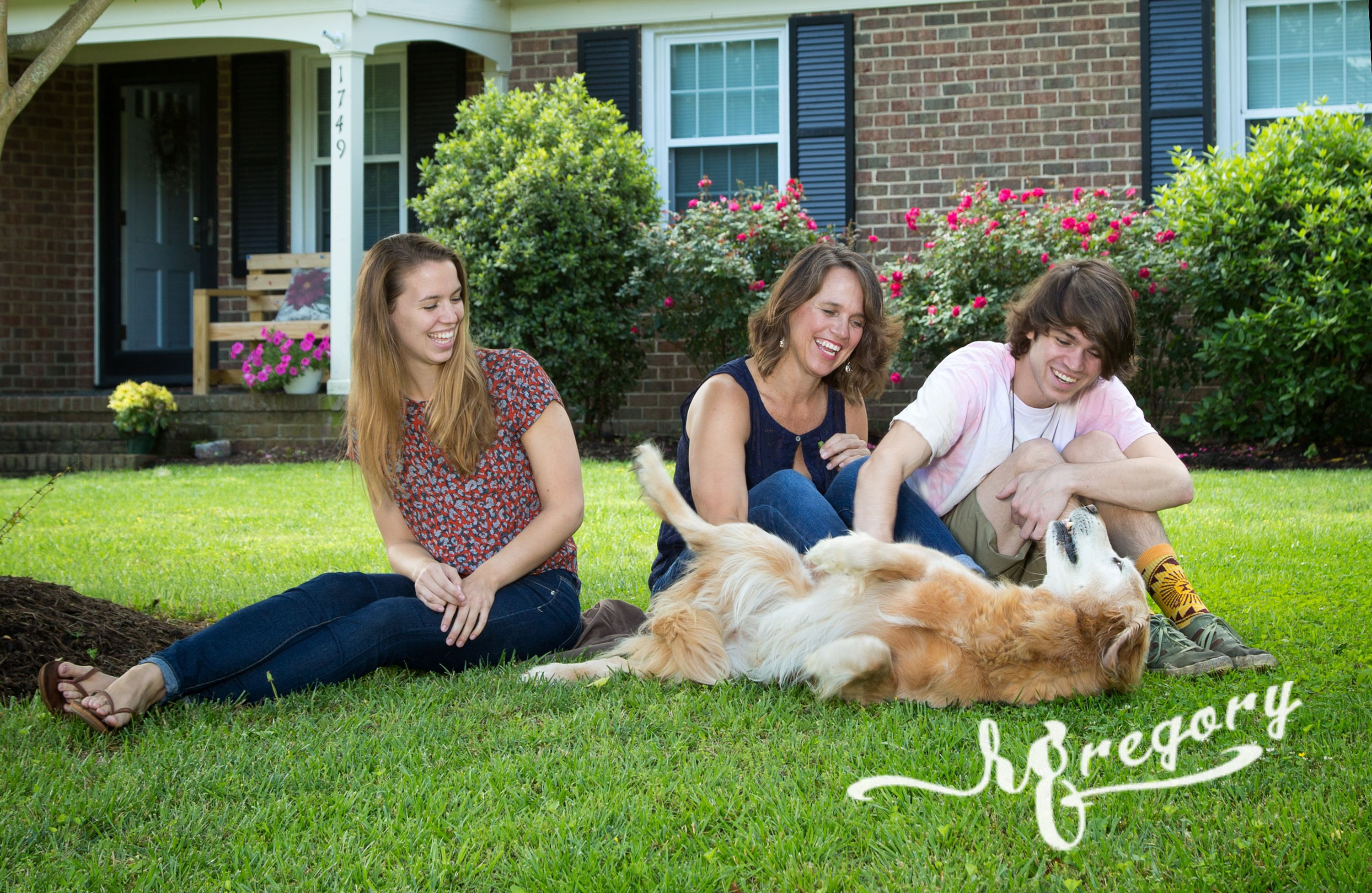 Parcells candid family shot on front lawn with pet dog