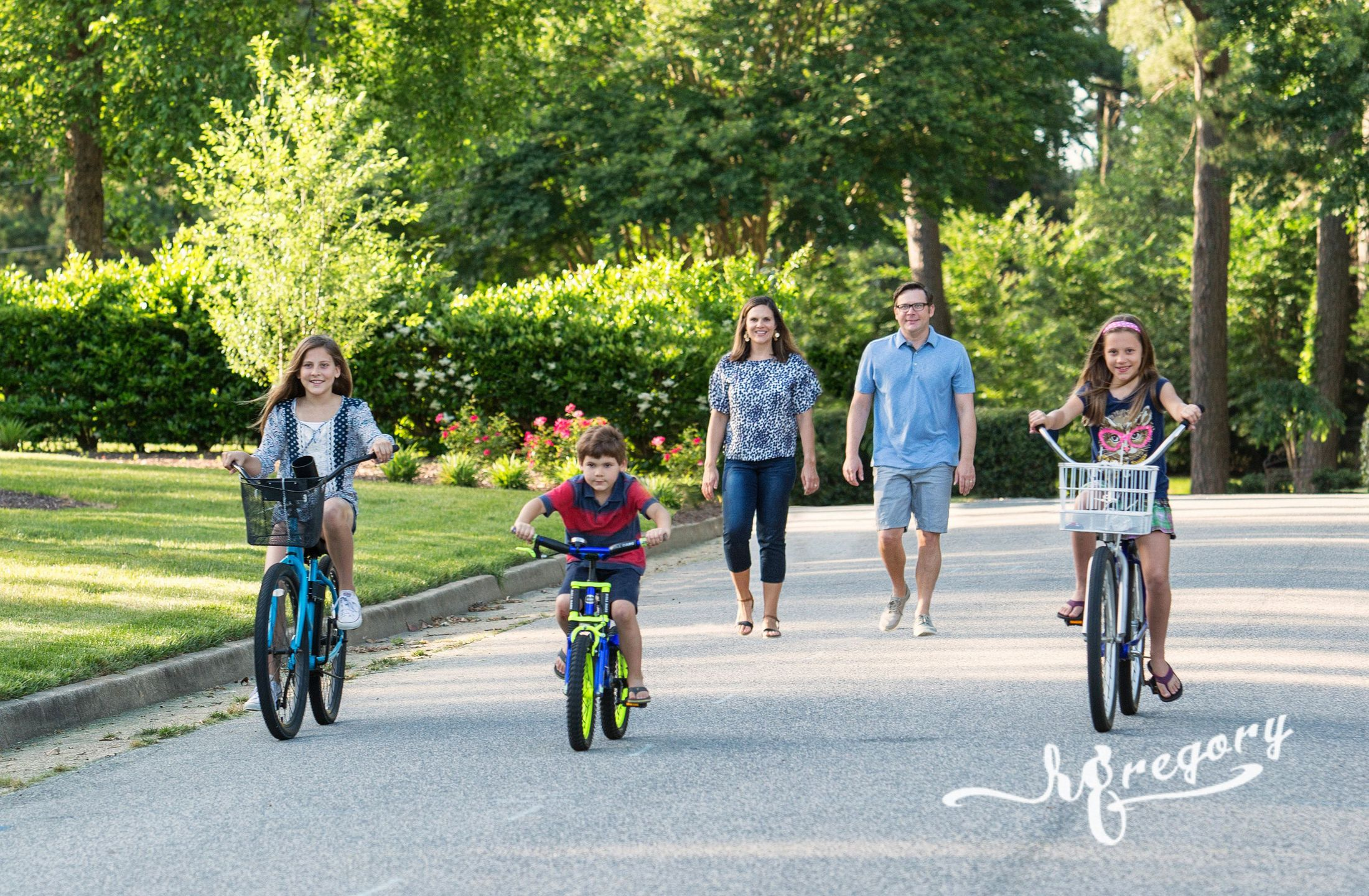 Zeimer candid family photo children bikes walking