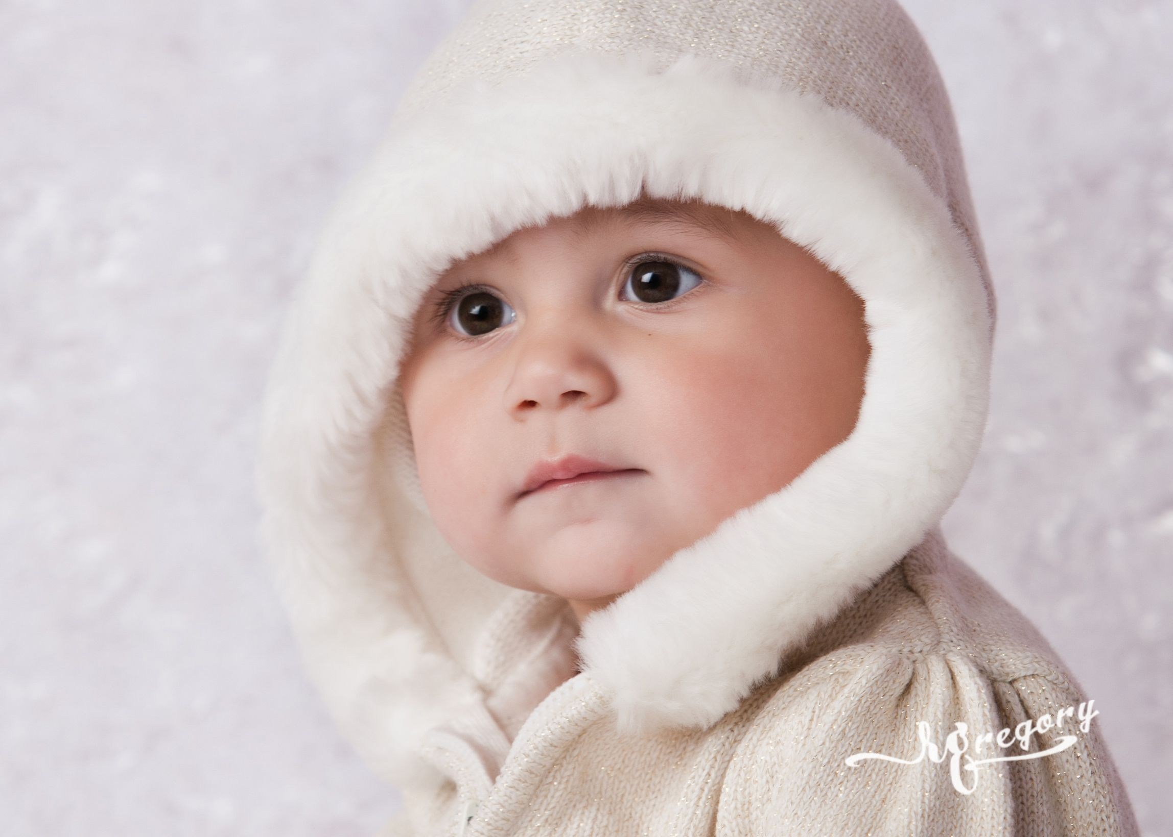 sweet baby face child photo in white fleeced hood